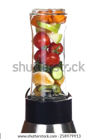 Conceptual image - fresh fruits and vegetables in a mixer on a white background. - stock photo