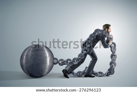 Conceptual image of a businessman pulling a heavy ball - stock photo