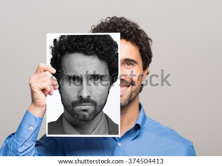 Conceptual image of a man changing his mood - stock photo