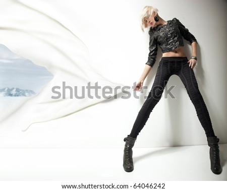 Conceptual image of a young fashionable beauty - stock photo