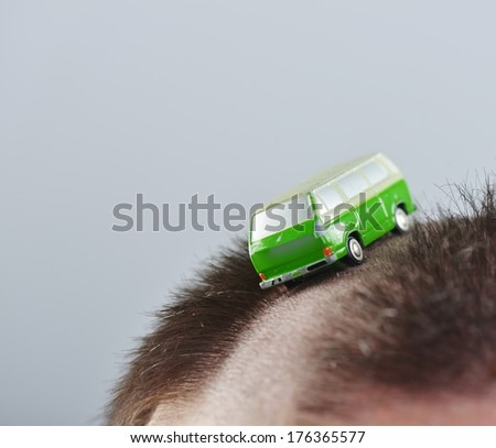 Conceptual image of alternative road for cars on man's head - stock photo