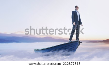 conceptual image of an ambitious businessman - stock photo