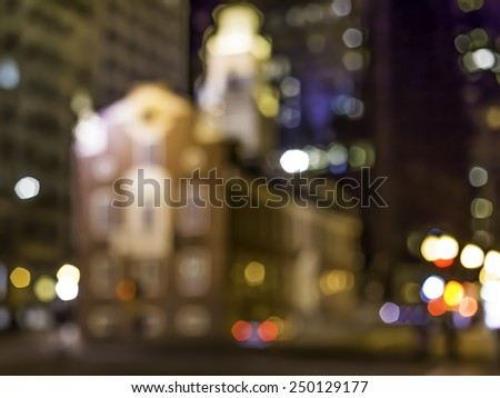 Conceptual image of Boston in MA, USA showcasing the street light of the city and the shape of the historic building of the Old Massachusetts State House in front of the Famous Massacre Place. - stock photo