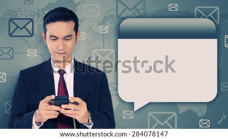 Conceptual image of business and communication technology. Young Asian businessman texting with mobile interface panel on his side, on  message icon graphic composition background - stock photo