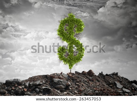 Conceptual image of green dollar sign growing on ruins - stock photo