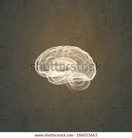 Conceptual image of human brain against grey background - stock photo