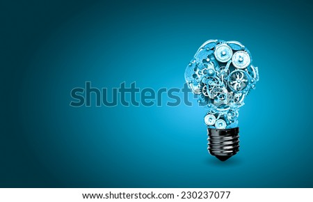 Conceptual image of light bulb with cogwheels inside - stock photo