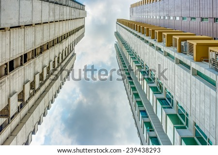 Conceptual image of old abandoned building and new building - stock photo