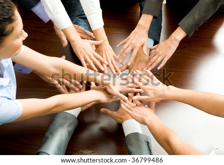 Conceptual image of people keeping their hands close to each other - stock photo