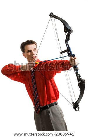 Conceptual image of serious man taking aim at something - stock photo