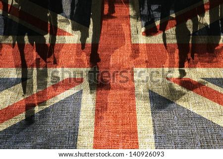 Conceptual image of shoppers overlaid onto UK flag. - stock photo