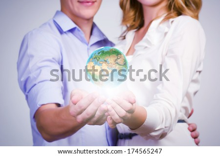Conceptual image of young couple hugging each other and dreaming. elements of this image are furnished by NASA - stock photo