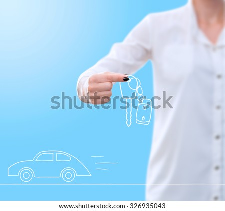 conceptual image , showing a woman's hand holding / giving away a card key drawing while at the same time a car drawing is speeding underneath - stock photo