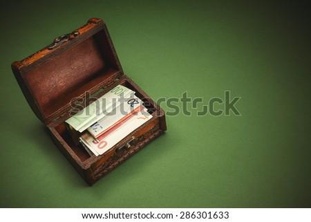 Conceptual image showing souvenir suitcase full of euro banknotes.  - stock photo