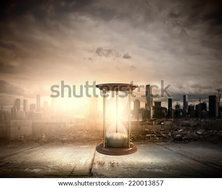 Conceptual image with huge sandglass. Time concept - stock photo