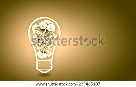 Conceptual image with light bulb filled with gears - stock photo
