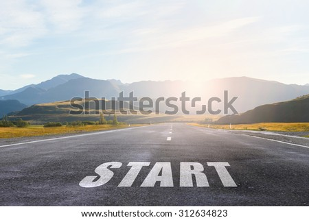 Conceptual image with word start on asphalt road - stock photo