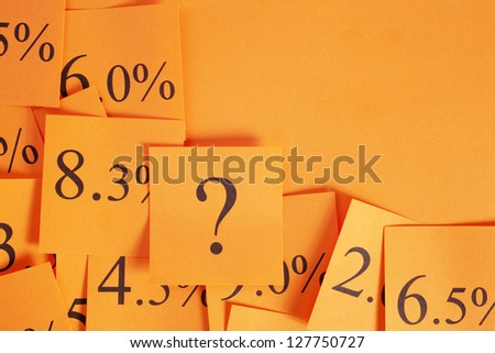 Conceptual look at variable interest or mortgage rates with copy space, in hot orange. - stock photo