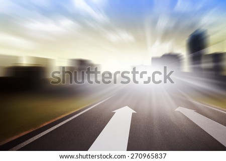 Conceptual of fast moving speedy highway. With arrow up - stock photo