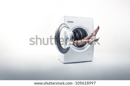 Conceptual photo of a woman absorbed by household duties - stock photo