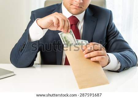 Conceptual photo of bribed politician taking envelope with money - stock photo
