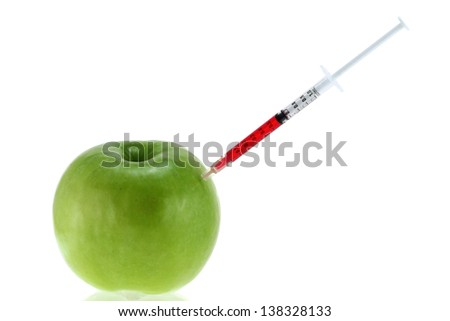 Conceptual photo of Genetic Modification - Red Liquid injecting to a Green Apple - stock photo