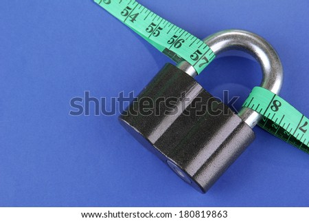 Conceptual photo of unlocking  secret of weight loss. On color background - stock photo