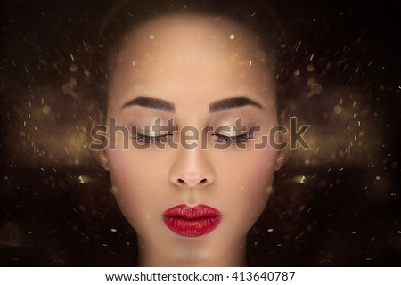 Conceptual photo of young african american woman with glamour makeup. - stock photo