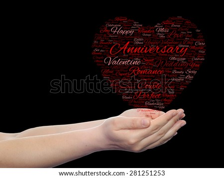Conceptual red love or Valentine`s Day wordcloud text in shape of heart symbol held in hands on black background for love, romance, passion, romantic, emotion, marriage, valentine, desire or affection - stock photo