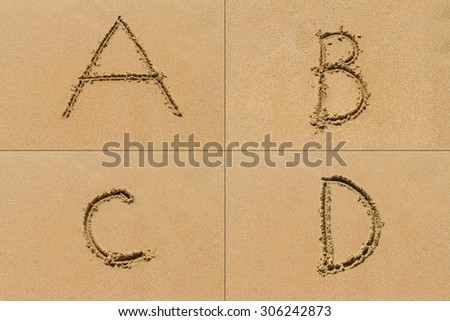 Conceptual set of A B C D letter of the alphabet written on sand with upper case. - stock photo