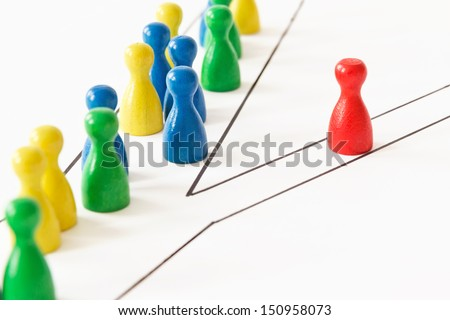 Conceptual shot from game figurines: road less traveled - stock photo