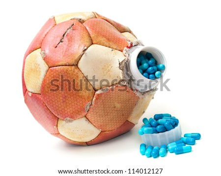 Conceptual view about doping in Soccer on a white background. - stock photo