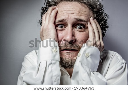 concern for the future, man with intense expression, white shirt - stock photo
