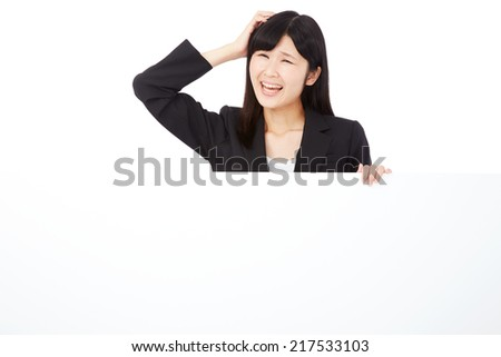 concerned businesswoman with Bulletin Board - stock photo
