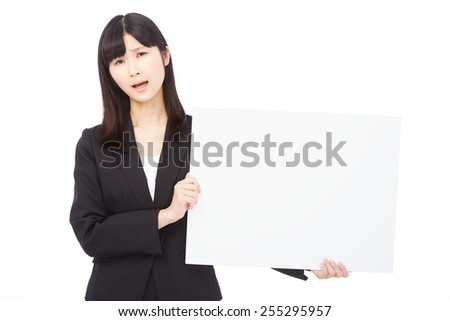 concerned Japanese businesswoman with Bulletin Board - stock photo