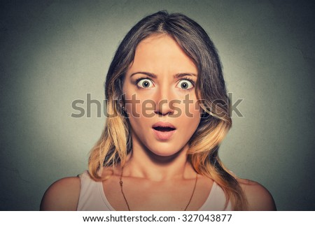 Concerned scared shocked woman - stock photo