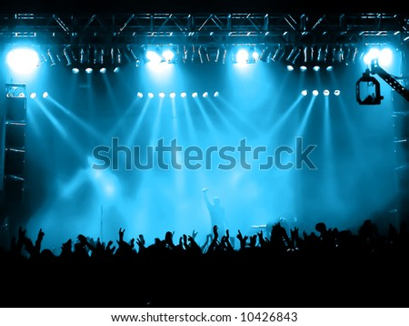 concert crowd - time exposure at a concert - stock photo