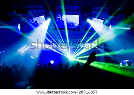 Concert, laser show, blurred motion - stock photo