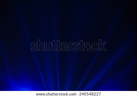 concert lighting against a dark background  - stock photo