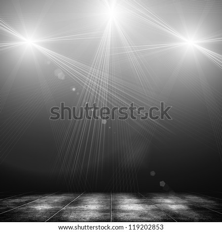 concert spot lighting over dark background and tile floor - stock photo