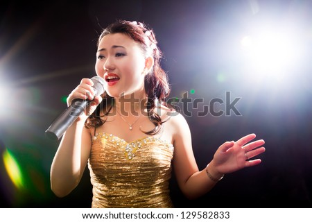 Concert young Asian singer of the girl - stock photo