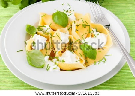 Conchiglioni with ricotta and basil - stock photo