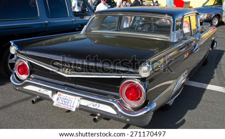 CONCORD, NC -- APRIL 11, 2015:  A 1959 Ford Fairlane 500 automobile on display at the Charlotte AutoFair classic car show held at Charlotte Motor Speedway. - stock photo