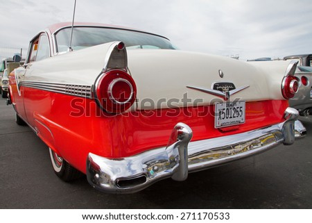 CONCORD, NC -- APRIL 11, 2015:  A 1956 Ford Fairlane automobile on display at the Charlotte AutoFair classic car show held at Charlotte Motor Speedway. - stock photo