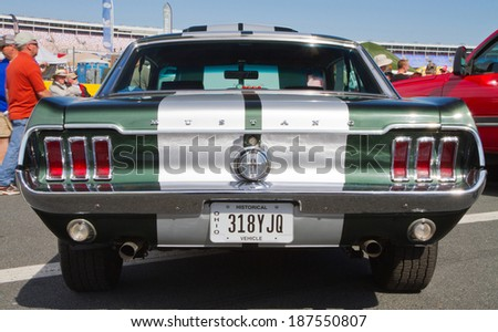 CONCORD, NC -- APRIL 05, 2014:  A 1967 Ford Mustang on display at the Charlotte AutoFair classic car show held at Charlotte Motor Speedway. - stock photo