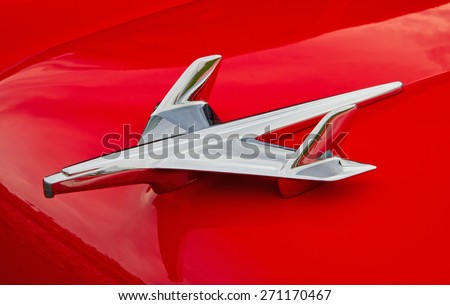 CONCORD, NC -- APRIL 11, 2015:  Close up of a 1955 Chevy hood ornament on display at the Charlotte AutoFair classic car show held at Charlotte Motor Speedway. - stock photo