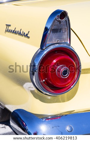 CONCORD, NC - APRIL 8, 2016:  Closeup of a 1955 Ford Thunderbird tail light on display at the Pennzoil AutoFair classic car show held at Charlotte Motor Speedway. - stock photo