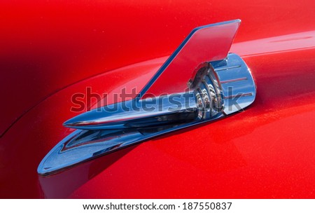 CONCORD, NC -- APRIL 05, 2014:  Closeup of a hood ornament on a 1957 Chevrolet Bel Air on display at the Charlotte AutoFair classic car show held at Charlotte Motor Speedway. - stock photo