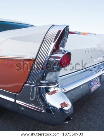 CONCORD, NC -- APRIL 05, 2014:  Closeup of tail fin on a 1957 Buick Super Riviera on display at the Charlotte AutoFair classic car show held at Charlotte Motor Speedway. - stock photo