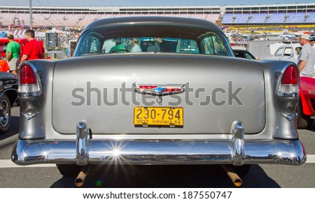 CONCORD, NC -- APRIL 05, 2014:  Rear view of a 1955 Chevrolet Bel Air on display at the Charlotte AutoFair classic car show held at Charlotte Motor Speedway. - stock photo